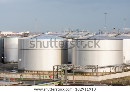 Loads of Oil Storage Tanks in Harbour Area - stock photo