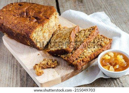 Loaf of banana bread with apple confiture - stock photo