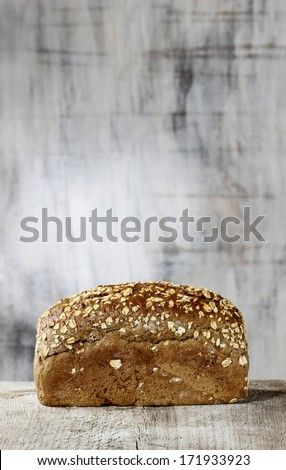 Loaf of bread. Grey background, copy space - stock photo