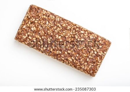 Loaf of wholemeal bread covered in sunflower seed, isolated on white background - stock photo
