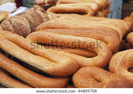 loafs of long bagels on market stand - stock photo