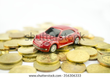 Loan Finance Concepts, toy car with coins as background - stock photo