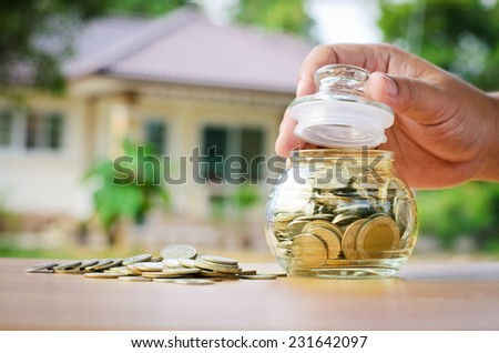 Loan,money coins with home, Saving for buy home concept - stock photo