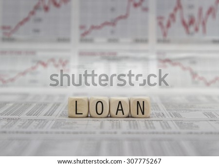 Loan word built with letter cubes - stock photo