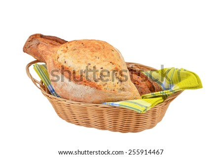 Loaves of bread in the basket isolated on white background - stock photo