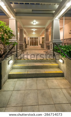 Lobby area, entrance of a townhouses complex, hotel, office. Fragment of the modern lobby, entrance. Interior design. Vertical. - stock photo