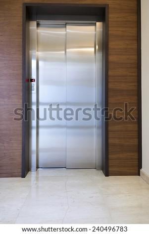 Lobby interior with elevator door  - stock photo