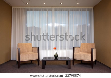 Lobby of hotel with sofas and a window - stock photo