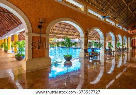Lobby of the  luxury caribbean, tropical hotel, resort. Reception area. Interior design. - stock photo