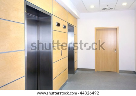 lobby with elevators in the office building - stock photo