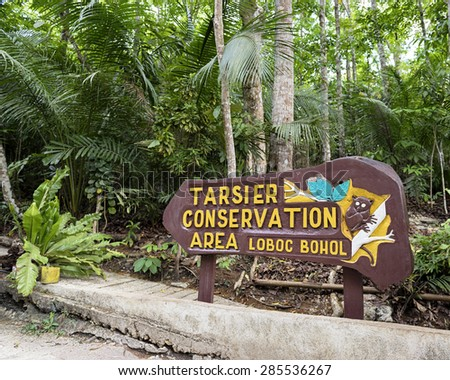 Loboc Town,  Bohol, Philippine Islands - May 29, 2015: Entrance sign  at the Tarsier Conservation Area in Lobol, Bohol Island. - stock photo