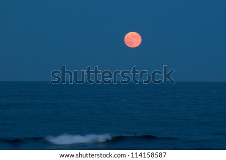 Lobster buoys and the full moon. Gloucester, Cape Ann, Massachusetts. - stock photo