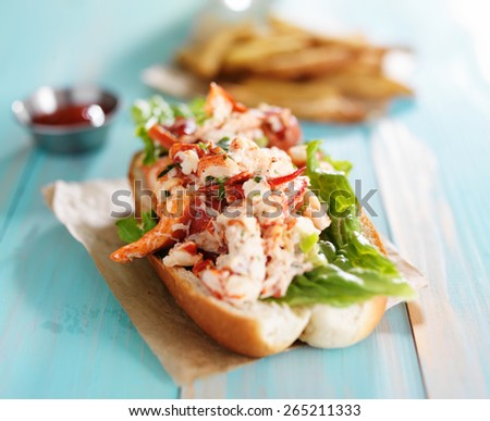 lobster roll on colorful retro painted wooden planks - stock photo