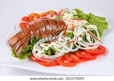 lobster served with mayonnaise, tomatoes and salad. - stock photo