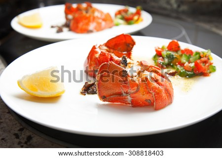 Lobster tail and filet steak meal - stock photo