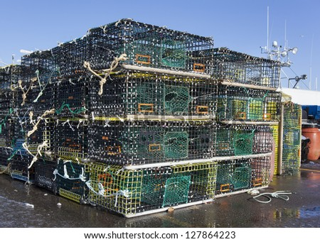 Lobster traps also know as pots,  on a pier ready to go out to sea. - stock photo