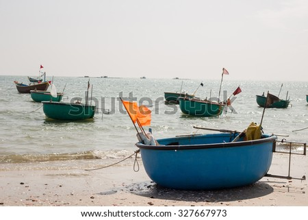 Local a basket boat at Fishing village, a famous tourist destination in Mui Ne, Vietnam.  - stock photo