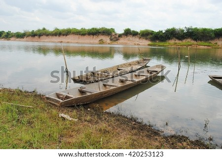 Local fishing boats Freshwater fishing boats, wooden boats, small boats, ships, steel, zinc, plastic boat in Southeast Asia. - stock photo