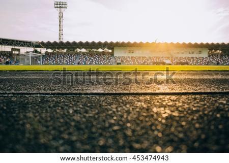 Local stadium and running track - stock photo