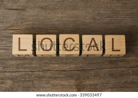 LOCAL text on a wooden background - stock photo
