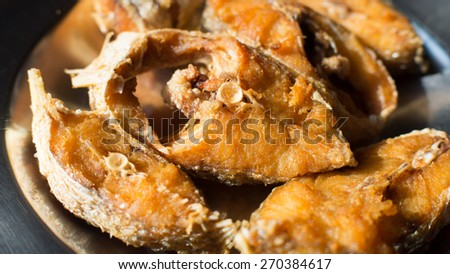 Local Thai food, fish fried in plate, high calcium and healthy food - stock photo