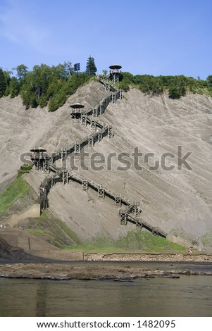 Located next to the Montmorency Falls in Quebec city, these wodden stairs allow hikers to climb up this very high cliff. - stock photo
