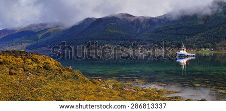 Loch Duich, Highland, Scotland. Tranquil midday landscape, low tide. - stock photo