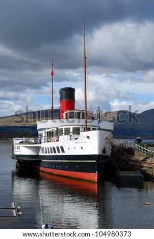 LOCH LOMOND, SCOTLAND - MAY 27: The paddle steamer 'Maid of the Loch' has just been fully restored for operation on the beautiful Scottish Loch Lomond, Scotland on May 27, 2012. - stock photo