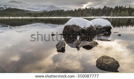 Loch Morlich in Winter. - stock photo