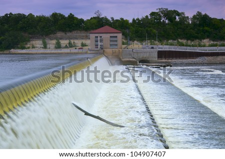 Lock and Dam Number One powerhouse on far side of spillway and Mississippi River in Highland Park Minnesota - stock photo