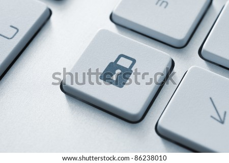 Lock button on the keyboard. Toned Image. - stock photo