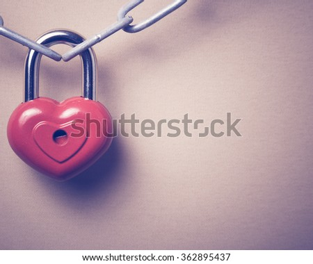 Lock in the form of a heart. - stock photo
