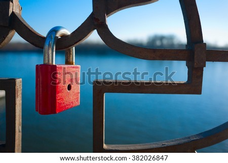 lock,lock iron,locked,river,outside,object,red lock iron,iron fence,detail - stock photo