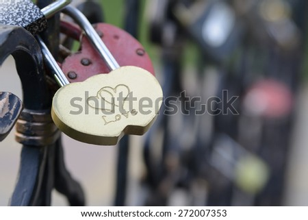 lock on a bridge in the shape of heart - stock photo