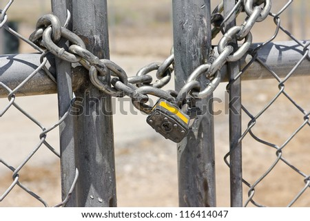 Lock on a chain link security fence. - stock photo