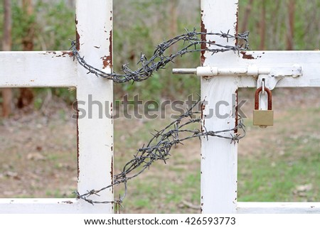 Lock the door with barbed wire - stock photo