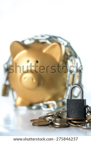 Lock your piggy money  for protect from hacker on your keyboard. - stock photo