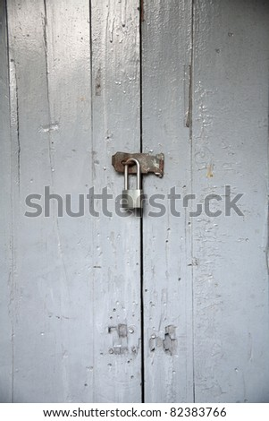 locked door with key - stock photo