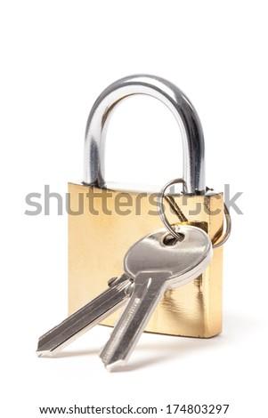 Locked padlock with keys isolated on white background. - stock photo