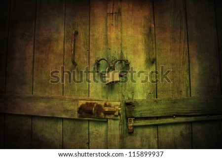 Locked wooden door with padlock - stock photo