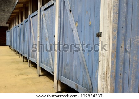 locker room with light blue rows of lockers - stock photo