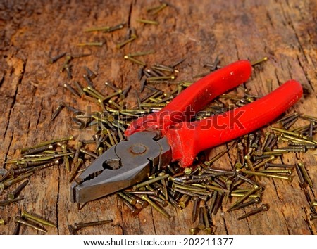 locking pliers and red pliers - stock photo