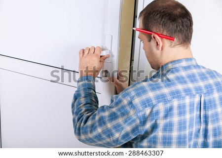Locksmith, lock, door. - stock photo