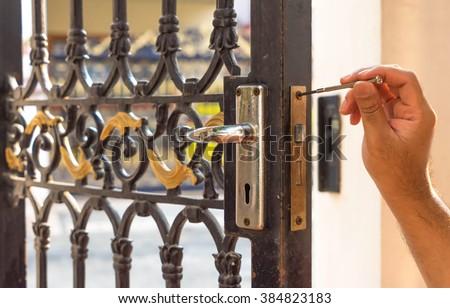 locksmith on old blue steel door for maintain - stock photo