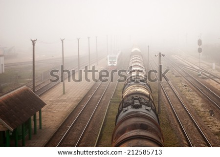 locomotive train in fog on station background - stock photo
