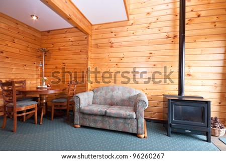 Lodge apartment interior with fireplace. Fox Glacier Lodge, Fox Glacier, West Coast, South Island, New Zealand. - stock photo