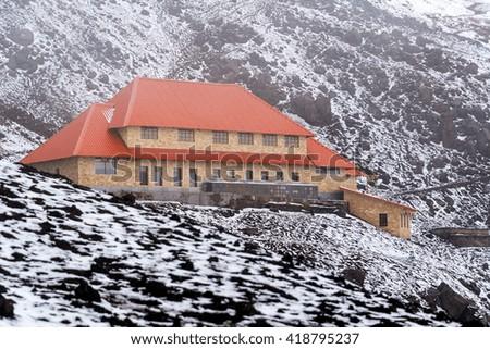 Lodge high up on Cotopaxi Volcano in Ecuador - stock photo