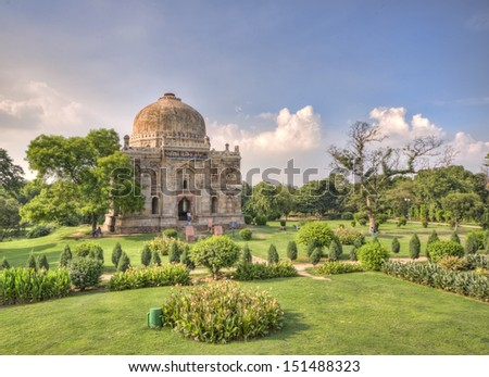 Lodi Gardens. Islamic Tomb (Seesh Gumbad) set in landscaped gardens. 15th Century AD. New Delhi, India. - stock photo