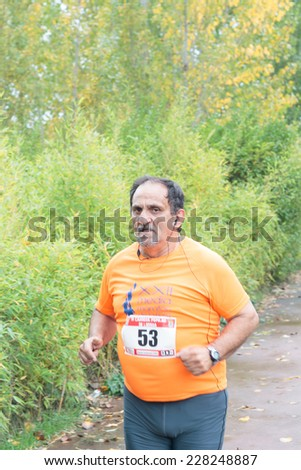 LODOSA - SPAIN - NOVEMBER 02: A senior athlete in the first run solorunners in Lodosa. Celebrated in Lodosa on November 02, 2014 - stock photo