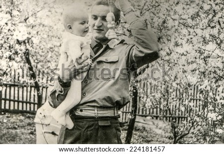 LODZ, POLAND, CIRCA MAY 1966: Vintage photo of father with little son - stock photo